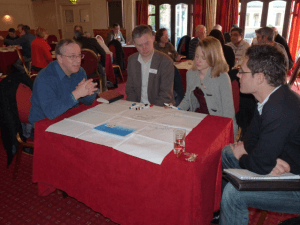 Delegates around a table on one of our effective training courses